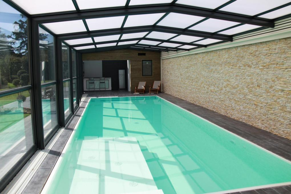 Véranda télescopique piscine